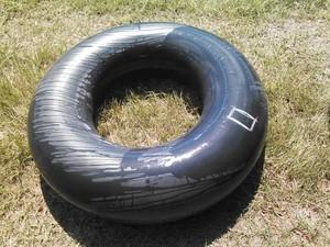300x225 Tire, in Flat tractor tire, by John S. Quarterman, for OkraParadiseFarms.com, 3 September 2014