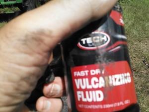 300x225 Vulcanizing fluid, in Flat tractor tire, by John S. Quarterman, for OkraParadiseFarms.com, 3 September 2014