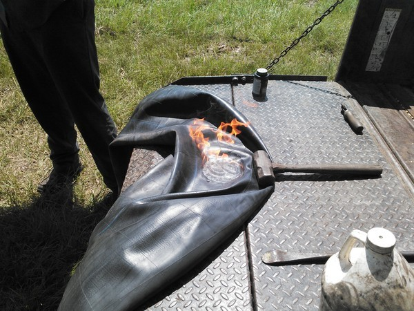 600x450 Fire, in Flat tractor tire, by John S. Quarterman, for OkraParadiseFarms.com, 3 September 2014