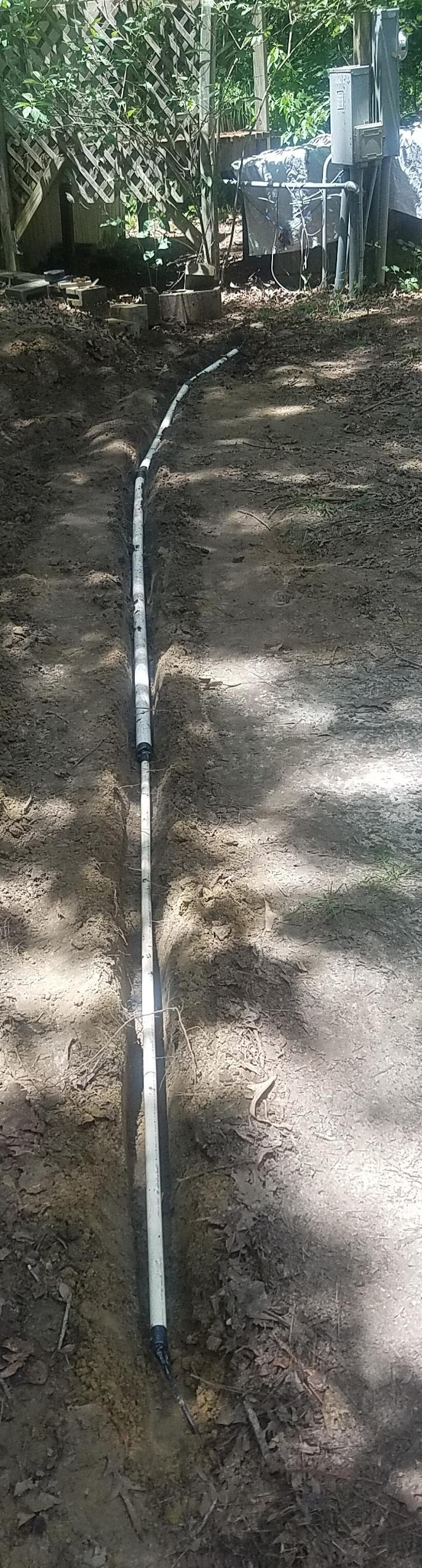 686x2549 Conduit in ditch, Cable, in Telephone conduit ditch, by John S. Quarterman, for OkraParadiseFarms.com, 24 May 2018